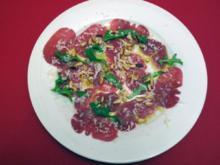 Hauchfeines Straußen-Carpaccio mit Pinienkernen - Rezept