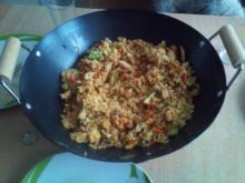 Curryreis mit geröstetem Schweinefleisch - Rezept