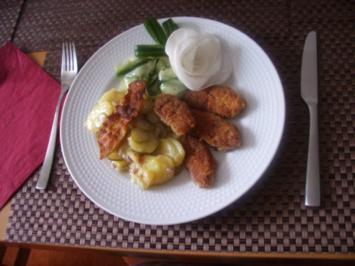 Schweinebäckchen  mit lauwarmen Kartoffelsalat und Bacon - Rezept
