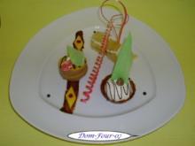 Vanillesahne im Florentinertörtchen & Schoko-Orangen-Sahne mit Mangoscheiben als Törtchen - Rezept