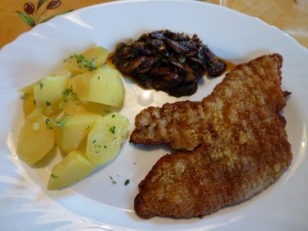 Kalbsschnitzel mit einem schwarzen Gemüse - Rezept