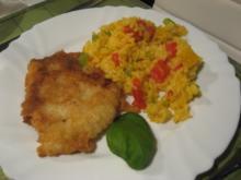 Seelachs-Filet im Bierteig auf buntem Paprika-Reis - Rezept