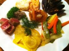 Fischvariationen an Gemüse ,Steinpilz-Ravoli und Olivenpesto - Rezept