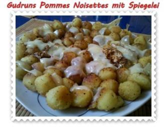 Kartoffeln: Pommes Noisettes mit Spiegelei und Bergkäse - Rezept