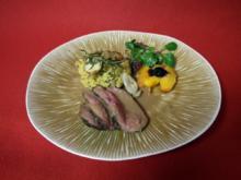 Rehlein an geschmorten Pfirsichhälften mit Steinpilz-Rosmarin-Risotto - Rezept