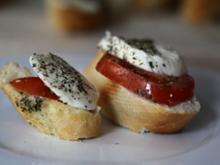 Kräuterbutterbaguette mit Tomate-Mozzarella - Rezept