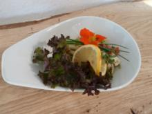 Octopussalat a la Giacomo mit Oliven und Brot als Amuse-Geul und Kir Royal - Rezept