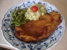 Riesen Wiesn-Schnitzel mit grünen Bohnen und Kohlrabi-Kartoffelstampf - Rezept