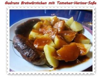Fleisch: Bratwürstchen mit Tomaten-Harissa-Soße und Pellkartoffeln - Rezept