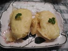 Vegetarisch : Mit Käse überbackene Kartoffeln und dazu einen Zwiebeljoghurt - Rezept