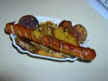 Gebratene Currybockwurst mit Kartoffelspalten - Rezept