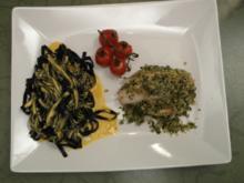 Fischknoten an schwarzen Bandnudeln auf einer Safransoße und geschmolzenen Tomaten - Rezept