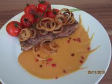 Rindersteaks mit fritierten Zwiebelringen und Tomaten - Rezept