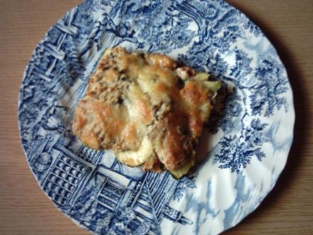 Zucchini - Tomaten - Auflauf auf Kartoffelschuppen - Rezept