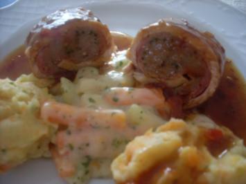 Pikant gefüllte Schweine-Roulade mit Kartoffel-Karotten-Stampf und Rahmgemüse - Rezept