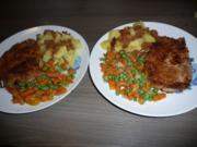 Kammkotelett  an Erbsen , Minikarotten und Salzkartoffeln. - Rezept