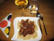Putenfilet in Chianti-Champignon-Sauce mit Penne Rigate - Rezept