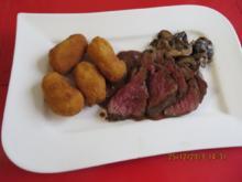 Kochen: Rinderfilet mit Glühwein-Pfeffersoße und Kroketten - Rezept