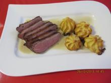 Kochen: Entenbrust mit Cognac-Pfeffersoße und Herzoginkartoffeln - Rezept