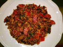 Fregola Sarda tostada mit Mangold, Speck, Salcicca und getrockneten Tomaten - Rezept