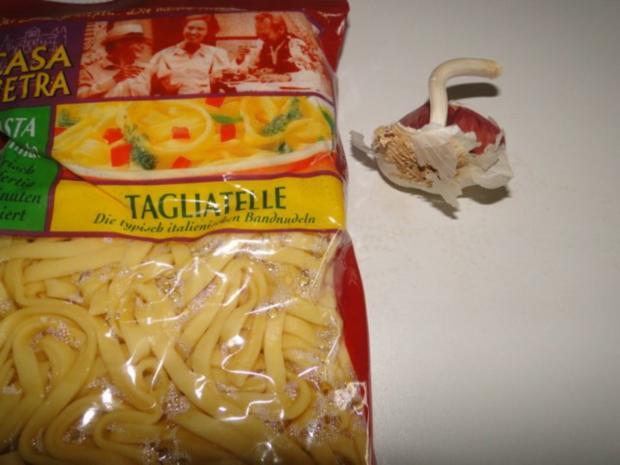 Garnelen und Tintenfischringe, gebraten in Knoblauch-Kräuter-Butter-Sauce - Rezept - Bild Nr. 5