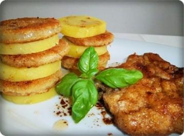 Rezept: Zwiebel – Kartoffelscheiben mit Schweinekoteletts.
