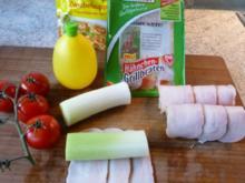 Auflauf: Porree-Hähnchenröllchen in Zwiebelsoße mit Käse überbacken - Rezept