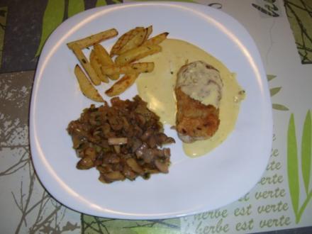 Gefüllte Putenmedaillon an Waldchampignons mit Pommes - Rezept