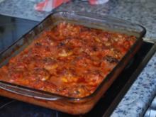Gefüllte Riesenchampignons in Tomaten-Sahnesoße - Rezept