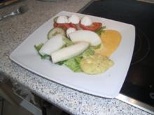Tintenfischfilet gekocht auf Salat - Rezept