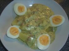 Eier in einer Käse-Speck Soße - Rezept