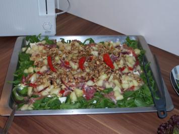 Rucola Melonen Salat mit Parmaschinken Schafskäse und Walnüssen - Rezept