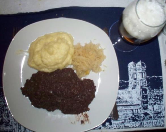 Grützwurst mit Sauerkraut und Kartoffelstampf - Rezept