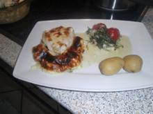 Seeteufel im Spinatbeet mit Tomatenmäuerchen - Rezept