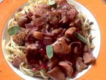 Spaghetti mit Steinpilzen in Rotwein - Preiselbeersoße - Rezept