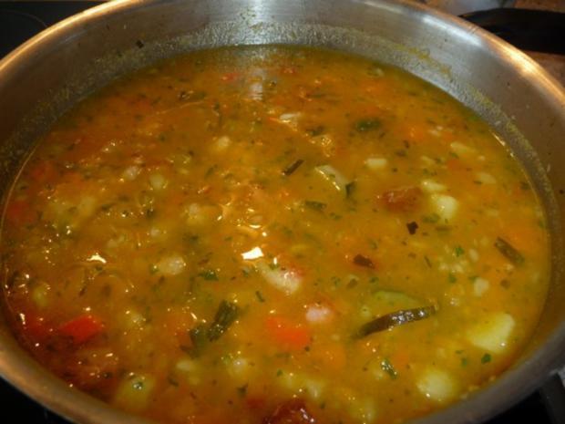 Butternut-Kürbis mit Zucchini, Kartoffeln und Speck - Rezept