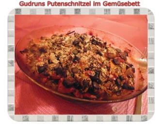 Fleisch: Pikantes Putenschnitzel im Gemüsebett - Rezept