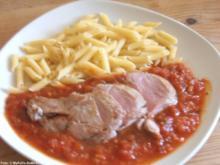 Schweinefilet auf Tomatensauce - Rezept