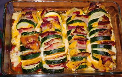 Zucchini- Fächer auf Schmortomaten - Rezept