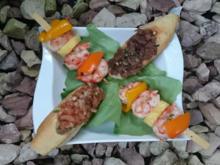 Garnelenspieß mit Ananas und Paprika an Lachs- und Thunfischtatar - Rezept