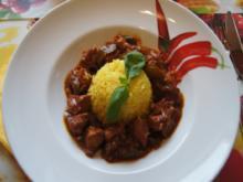 Putengulasch im Wok mit Curry-Blumenkohl-Reis - Rezept - Bild Nr. 2351