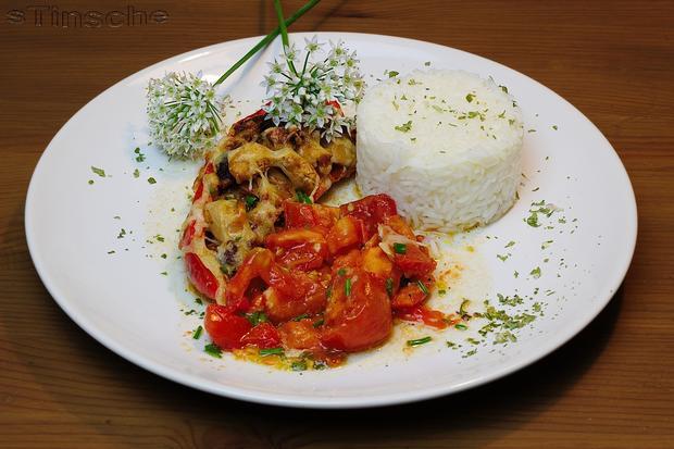 Gefüllte Paprika auf Schmortomaten - Rezept - Bild Nr. 3696