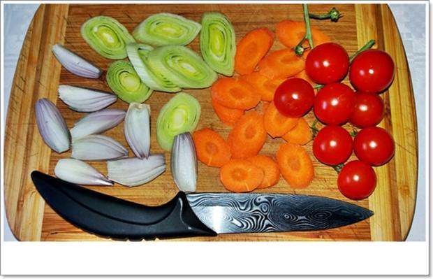 Gebackene Dorade aus dem Ofen, im Gemüsebett - Rezept - Bild Nr. 5358