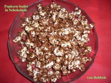 Rezept: Snack süß: Popcorn badet in Schokolade