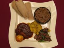 Tibs, Kitfo und Doro Wet mit Gemüse und äthiopischem Brot - Rezept
