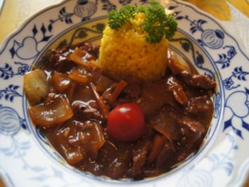 Rezept: Kalbsleber mit Ingwer und Gemüsezwiebel im Wok mit gelben Basmatireis