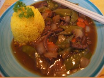 Rindfleisch mit Zuckerschoten im Wok und gelber Basmatireis - Rezept - Bild Nr. 2