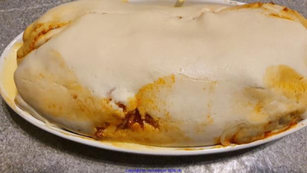 Bolognese in der Pizzateig Rolle als kleine Zwischenmahlzeit - Rezept - Bild Nr. 10420