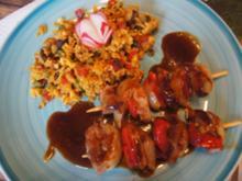 Schweinefiletspieße mit Paprika-Erbsen-Rosinen-Bratreis - Rezept - Bild Nr. 2