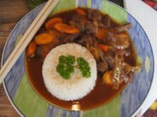Rindfleisch mit Möhren-Zwiebel-Gemüse im Wok und Basmatireis - Rezept - Bild Nr. 2